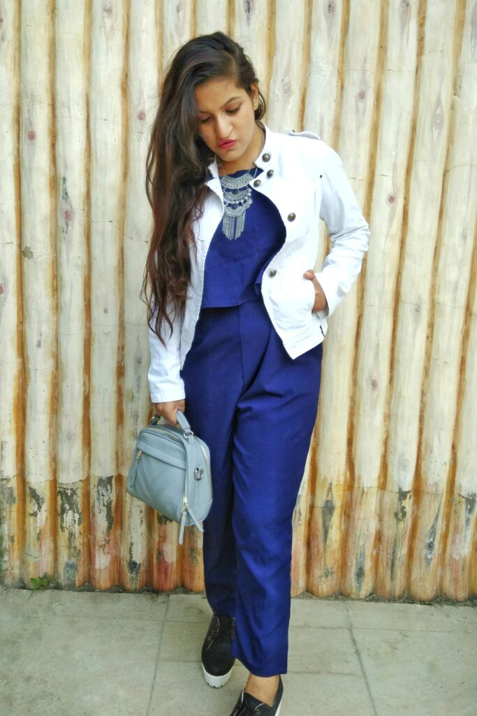 white jacket blue jumpsuit